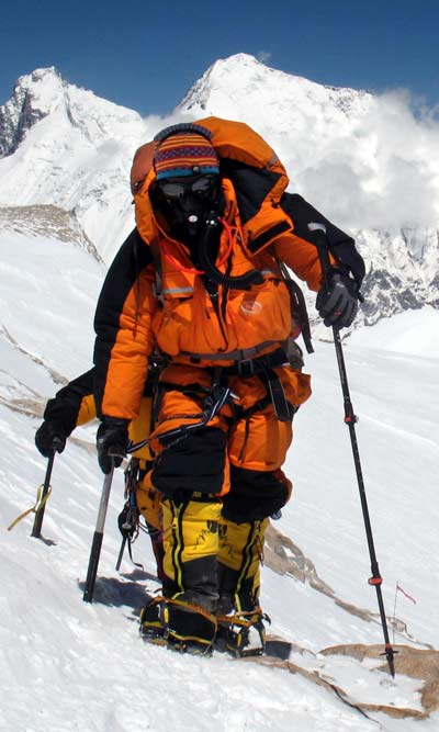 Adele Pennington approaching Makalu Summit in PHD Omega Down Suit