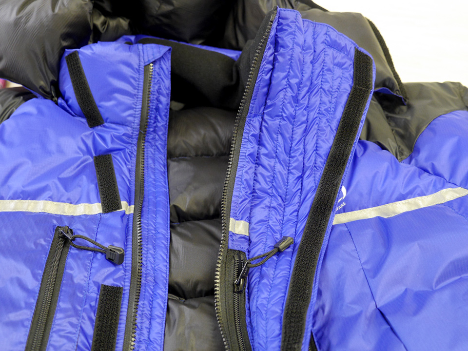 Jacket showed flared over-baffle (to protect water drips from oxygen-mask freezing on zip)