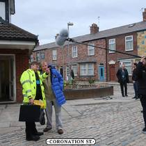 PHD's cover coat on set with the cast of Coronation Street
