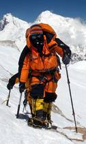 Adele Pennington approaching Makalu summit, PHD Omega Down Suit