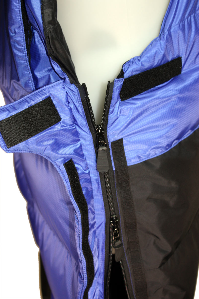 Side zips undo fully (at the top). No need to remove boots/crampons.